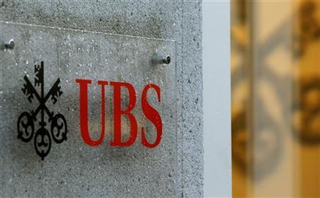 The company's logo is placed in front of an office of Swiss bank UBS in Zurich December 4, 2012. REUTERS/Arnd Wiegmann