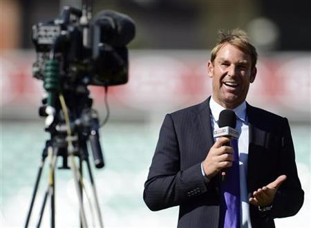 Former cricketer and commentator Shane Warne faces a television camera after the first cricket test match between England and South Africa at the Oval cricket ground in London July 23, 2012. REUTERS/Philip Brown/Files