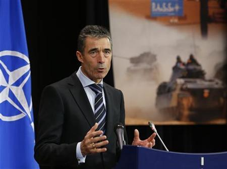 NATO Secretary-General Anders Fogh Rasmussen holds a news conference during a NATO foreign ministers at the Alliance's headquarters in Brussels December 4, 2012. REUTERS/Francois Lenoir