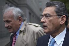 Former Goldman Sachs Group Inc board member Rajat Gupta leaves the U.S. District Court with his lawyer Gary Naftalis after he was sentenced in Manhattan, New York October 24, 2012. REUTERS/Adrees Latif