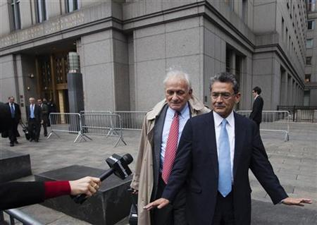 Former Goldman Sachs Group Inc board member Rajat Gupta (R) declines to comment as he departs Manhattan Federal Court with his lawyer, Gary Naftalis after being sentenced in New York, October 24, 2012. REUTERS/Lucas Jackson