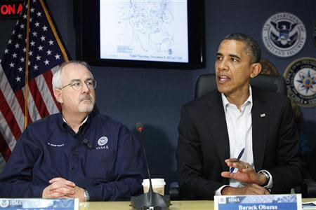 U.S. President Barack Obama (R), sitting with Federal Emergency Management Agency (FEMA) administrator William Craig Fugate (L), talks to reporters after a briefing about operations in the aftermath of Hurricane Sandy, at FEMA headquarters in Washington, November 3, 2012. REUTERS/Jonathan Ernst