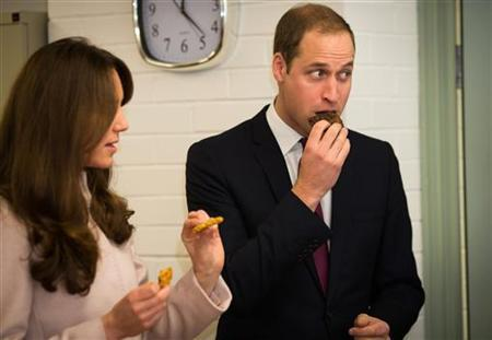 Britain's Catherine, Duchess of Cambridge and Prince William sample some biscuits during a visit to an accommodation and resettlement centre called 'Jimmy's' in Cambridge, central England November 28, 2012. REUTERS/Paul Rogers/Pool