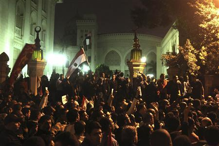 Protesters chant anti-Mursi slogans in front of the presidential palace in Cairo, December 4, 2012. Egypt's opposition called for mass protests on Tuesday against the Islamist-led government's drive to hold a snap referendum on a new constitution after sweeping aside judicial obstacles. REUTERS/Asmaa Waguih