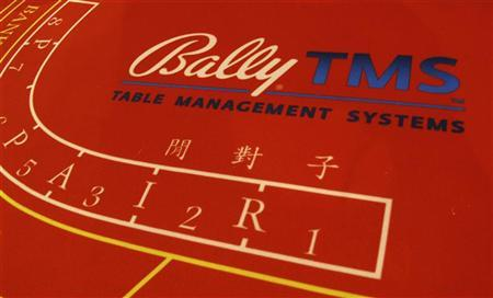 A gaming table of Bally Technologies is displayed at Global Gaming Expo Asia in Macau June 8, 2011. REUTERS/Bobby Yip