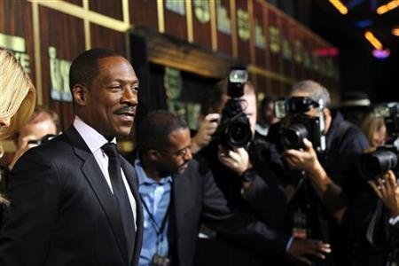 Actor Eddie Murphy (L) poses as he arrives for the taping of the Spike TV special tribute ''Eddie Murphy: One Night Only'' at the Saban theatre in Beverly Hills, California November 3, 2012. The program airs November 14. REUTERS/Mario Anzuoni
