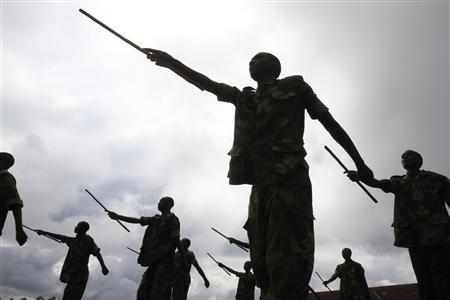 Recruits of the newly formed Congolese Revolutionary Army march during military training in Rumangabo military camp, Democratic Republic of Congo, October 23, 2012. REUTERS/James Akena