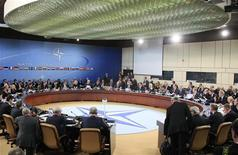 NATO foreign ministers meet at the Alliance's headquarters in Brussels December 4, 2012. NATO foreign ministers will agree on Tuesday to send Patriot missiles to beef up Turkey's air defenses and calm Turkey's fears that it could come under missile attack, possibly with chemical weapons, from Syria, diplomats said. REUTERS/Yves Herman
