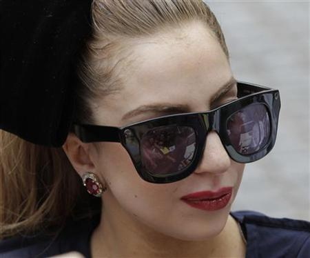 Singer Lady Gaga signs autographs for fans in front of Sheraton Hotel in Asuncion November 26, 2012. REUTERS/Jorge Adorno