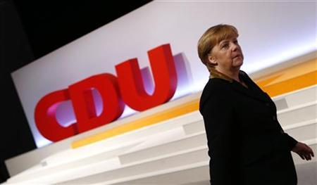 German Chancellor and leader of Germany's Christian Democratic Union (CDU) Angela Merkel walks up to the podium during the CDU's annual party meeting in Hanover, December 4, 2012. REUTERS/Kai Pfaffenbach