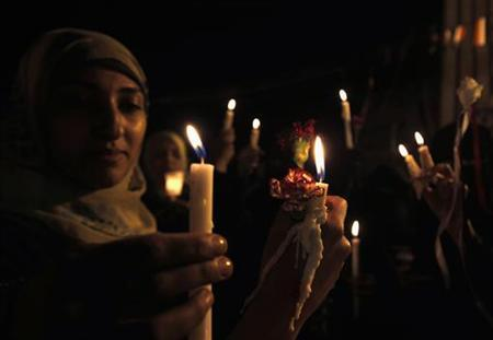 Women hold candles during a rally to commemorate the first anniversary of the death of Mohamed Bouazizi, the Tunisian man who set himself on fire in an act of protest which inspired the Arab Spring, in Sanaa December 17, 2011. REUTERS/Khaled Abdullah/Files