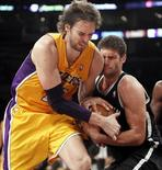 Los Angeles Lakers' Pau Gasol (L) of Spain fights for the ball with Brooklyn Nets' Brook Lopez during the second half of their NBA basketball game in Los Angeles November 20, 2012. REUTERS/Danny Moloshok