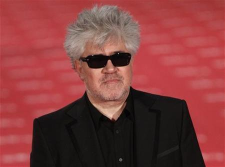 Spanish director Pedro Almodovar poses for photographers on the red carpet as he arrives for the Spanish Film Academy's Goya awards ceremony in Madrid, February 19, 2012. REUTERS/Andrea Comas