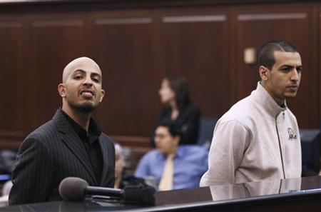Algerian-born Ahmed Ferhani (L), and Moroccan-born Mohammed Mamdouh stand before a judge during their arraignment in Manhattan criminal court in New York May 12, 2011. REUTERS/Lucas Jackson/Files