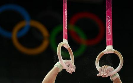 The hands of Andreas Toba of Germany are pictured as he competes in the rings during the men's gymnastics team final in the North Greenwich Arena during the London 2012 Olympic Games July 30, 2012. REUTERS/Dylan Martinez