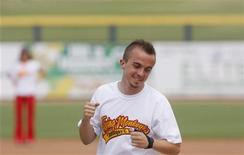 Actor Frankie Muniz gestures during a charity kickball game in Peoria, Arizona August 11, 2009. REUTERS/Joshua Lott