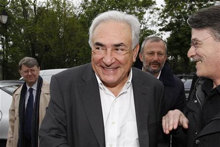 Former IMF head Dominique Strauss-Kahn (C) and Francois Pupponi (2ndR), Deputy Mayor of Sarcelles arrive at a polling station in the second round of the 2012 French presidential elections in Sarcelles May 6, 2012. REUTERS/Gonzalo Fuentes