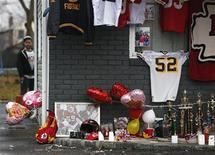 A makeshift memorial for Kansas City Chiefs football player Jovan Belcher is seen outside his mother's home in West Babylon, New York December 4, 2012. REUTERS/Shannon Stapleton