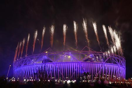Fireworks explode over the Olympic Stadium during the closing ceremony of the London 2012 Paralympic Games September 9, 2012. REUTERS/Olivia Harris