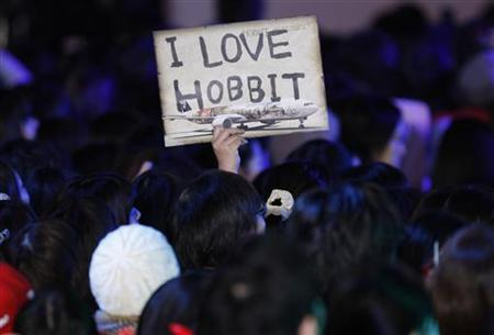 A fan holds up a sign upon the cast members' arrival at the Japan premiere of the movie 'The Hobbit - An Unexpected Journey' in Tokyo December 1, 2012. REUTERS/Issei Kato