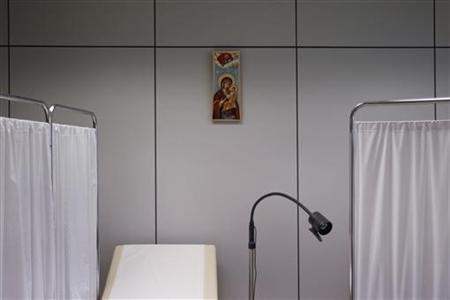 An icon depicting Virgin Mary holding Jesus Christ is seen inside a medical centre which has been set up by volunteers at the headquarters of the Athens Medical Association with the contribution of the Greek Orthodox Church in Athens May 25, 2012. REUTERS/Yorgos Karahalis