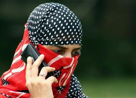 A girl speaks on a mobile phone in Jammu August 24, 2007. REUTERS/Amit Gupta/Files