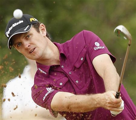 Justin Rose of England hits out of a bunker on the 14th hole during the Nedbank Golf Challenge in Sun City, December 1 2012. REUTERS/Siphiwe Sibeko