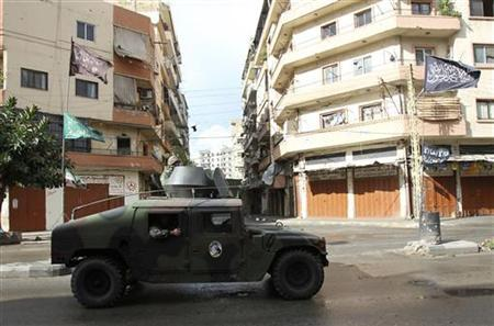 Lebanese army soldiers patrol in their vehicle in the Sunni Muslim-dominant neighbourhood of Bab al-Tebbaneh in Tripoli, northern Lebanon, during clashes between Sunni Muslims and Alawites December 4, 2012. REUTERS/Omar Ibrahim