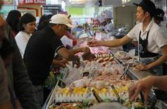 Customers buy produce at a grocery store inside a mall in Manila's Makati financial district November 29, 2012. REUTERS/Romeo Ranoco