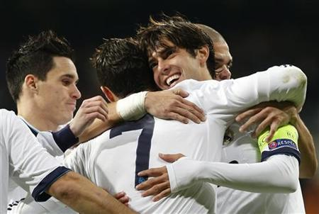 Real Madrid's Kaka (2nd R) is embraced by his teammate Cristiano Ronaldo, next to teammates Jose Callejon (L) and Pepe (R), during their Champions League Group D soccer match against Ajax Amsterdam at Santiago Bernabeu stadium in Madrid, December 4, 2012. REUTERS/Juan Medina