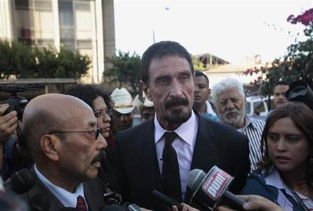 John McAfee (C), anti-virus software guru, attends a news conference with his lawyer Telesforo Guerra (L) outside of the Supreme Court of Justice in Guatemala City, December 4, 2012. REUTERS/William Gularte