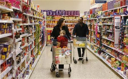 Customers shop at a Tesco shop in Bishop's Stortford, southern England November 26, 2012. REUTERS/Suzanne Plunkett