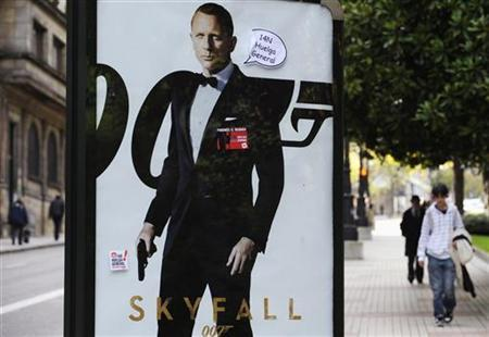 Stickers calling for a general strike sit on an advert of the James Bond's movie ''Skyfall'' in Oviedo, November 12, 2012. REUTERS/Eloy Alonso