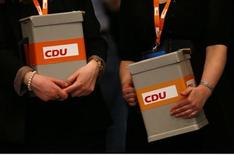 Helpers of Germany's Christian Democratic Union (CDU), hold voting boxes during the CDU's annual party meeting in Hanover, December 4, 2012. REUTERS/Kai Pfaffenbach