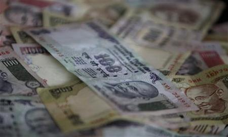 Rupee notes are seen in this picture illustration taken in Mumbai April 30, 2012. REUTERS/Vivek Prakash/Files