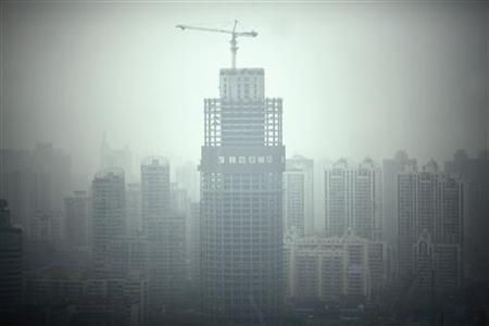 A view of downtown Shanghai on a hazy day is seen on May 15, 2012. REUTERS/Carlos Barria/Files