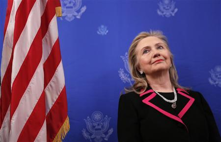 U.S. Secretary of State Hillary Clinton looks up as she is introduced to speak at the residence of the U.S. ambassador to Belgium in Brussels December 4, 2012. REUTERS/Kevin Lamarque