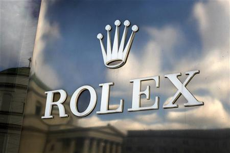 The Rolex logo is seen outside of a shop in Warsaw March 6, 2011. REUTERS/Kacper Pempel