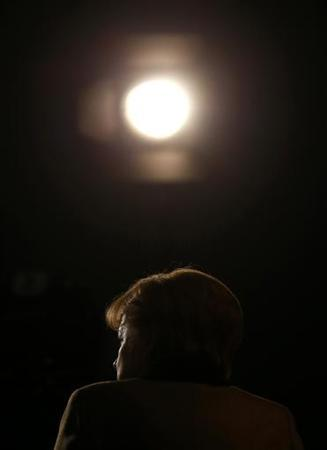German Chancellor and leader of Germany's Christian Democratic Union (CDU), Angela Merkel waits for a TV interview at the end of the CDU's annual party meeting in Hanover, December 5, 2012. REUTERS/Kai Pfaffenbach (GERMANY - Tags: POLITICS)