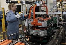 A Ford Motor production worker assembles batteries for Ford electric and hybrid vehicles at the Ford Rawsonville Assembly Plant in Ypsilanti Twsp, Michigan November 7, 2012. REUTERS/Rebecca Cook