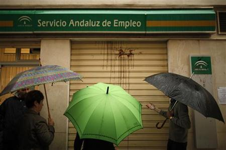 People wait in line to enter a government job centre in Malaga, southern Spain April 29, 2011. REUTERS/Jon Nazca