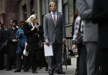 Job seekers stand in line to meet with prospective employers at a career fair in New York City, October 24, 2012. REUTERS/Mike Segar
