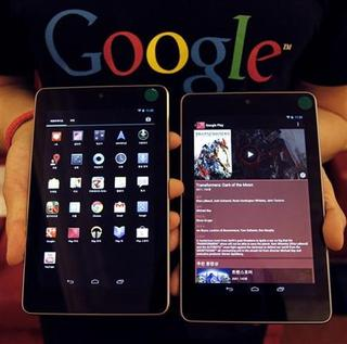 A Google employee poses with Nexus 7 tablets at a promotional event in Seoul September 27, 2012. REUTERS/Kim Hong-Ji