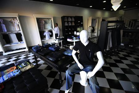 A customer looks at clothes inside the ''Luxury'' shop in Khartoum November 29, 2012. REUTERS/ Mohamed Nureldin Abdallah