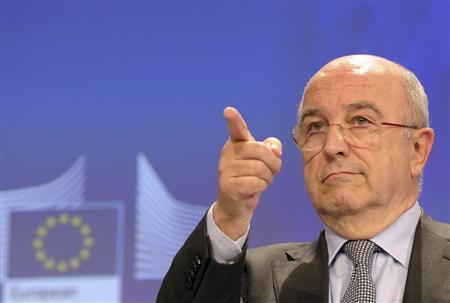 European Union Competition Commissioner Joaquin Almunia gestures during a news conference at the EU Commission headquarters in Brussels December 5, 2012. REUTERS/Laurent Dubrule