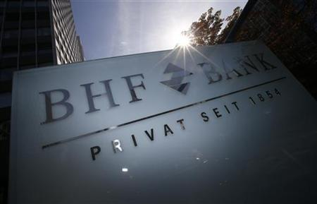 The BHF-Bank sign is pictured in front of its headquarters in Frankfurt September 20, 2012. REUTERS/Kai Pfaffenbach