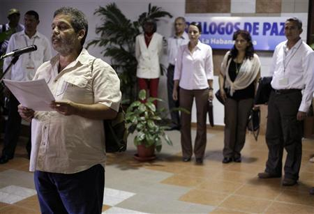 Members of the Colombia's FARC rebel force Marco Leon reads a document before talks in Havana December 5, 2012. Colombia's Marxist-led FARC rebels said their peace talks with the government were going well, but the lead negotiator for President Juan Manuel Santos was more reserved as the two sides finished the first round of meetings aimed at ending their protracted conflict. REUTERS/Enrique De La Osa