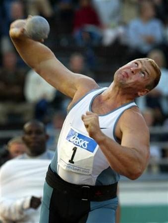 Ukraine's Yuriy Bilonog competes during men's shot put at the grand grix athletics meeting in Helsinki August 18, 2003. REUTERS/LEHTIKUVA/Ville Myllynen/Files