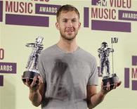 "DJ Calvin Harris poses backstage with statuettes after winning the award for ""Best Electronic Dance Music Video "" at the 2012 MTV Video Music Awards in Los Angeles, September 6, 2012. REUTERS/Danny Moloshok"