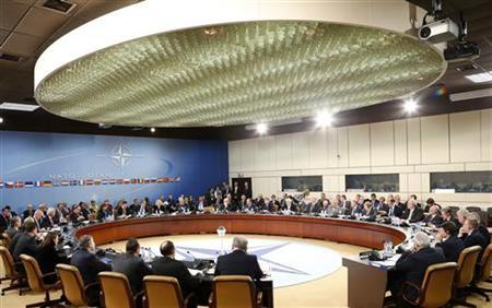 NATO Secretary General Anders Fogh Rasmussen (13th L)delivers a speech during a NATO-Georgia foreign ministers meeting at the Alliance headquarters in Brussels December 5, 2012. REUTERS/Francois Lenoir